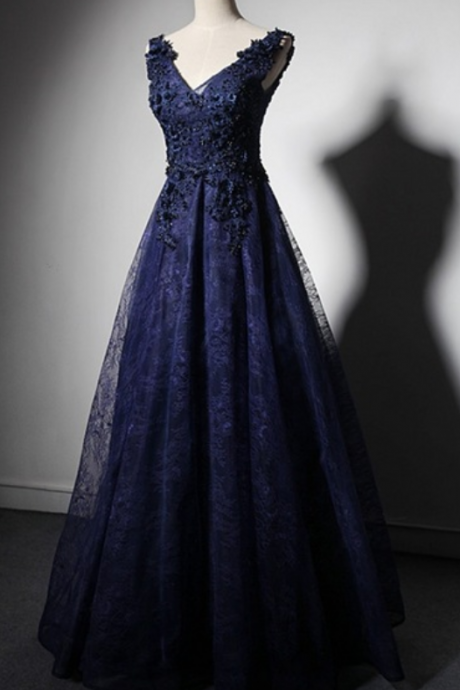 The dark blue lace dress evening party has officially started a stylish women's wedding gown at night in a lounge chair