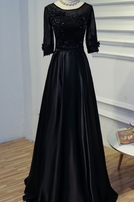 Long-sleeved black lace in a woman's satin dress and lady's formal wedding dress