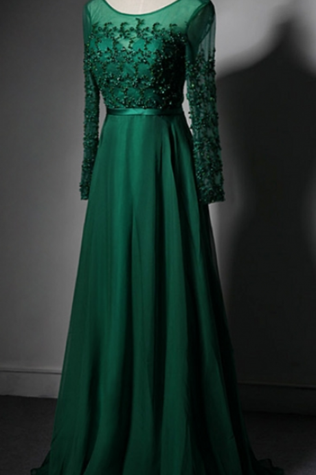 The emerald green long-sleeved evening party dress beautiful crystal begins the evening gown of the formal dress ball