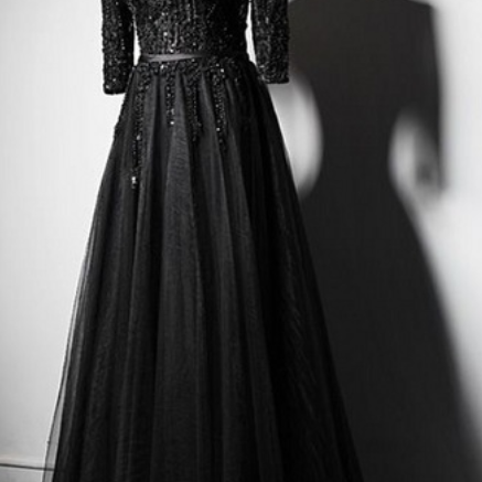 Black long sleeved dress for a woman's wedding bride to begin an elegant formal ball gown